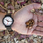 Mondaine essence watch and castor bean (PRNewsfoto/Mondaine Watch Ltd.)