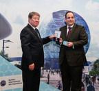 "Chairman of Astana EXPO 2017 Akhmetzhan Yessimov hands over the Order of Friendship to Dimitri Kerkentzes, Deputy Secretary General of the BIE (PRNewsfoto/National company ""Astana EXPO-20)"