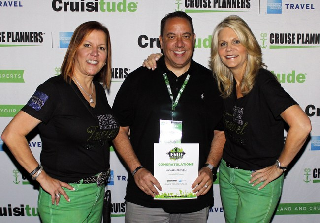 Cruise Planners® franchise owner, Michael Consoli, receiving #1 River Cruise Agent from Michelle Fee & Vicky Garcia, one of 6 awards Michael received at this years convention.