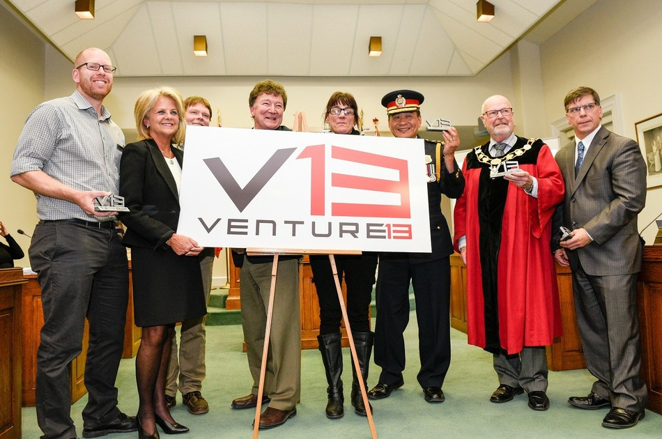 Venture13 partners reveal the new logo with Town of Cobourg Mayor Gil Brocanier. (CNW Group/Town of Cobourg)