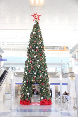 DFW's 37-foot tall Christmas Tree located in the North Village of Terminal D. (PRNewsfoto/DFW International Airport)