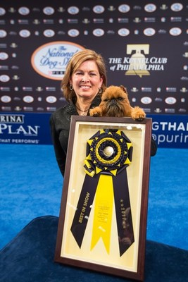 Newton, an 11-pound Brussels Griffon, and handler Susan DePew are all smiles after winning Best In Show at the National Dog Show Presented by Purina, broadcast Thanksgiving Day on NBC to a total audience of some 20 million.  Newton came out of the Toy Group to defeat six other top-tier show dogs in the Kennel Club of Philadelphia annual competition.  Credit: Steve Donahue