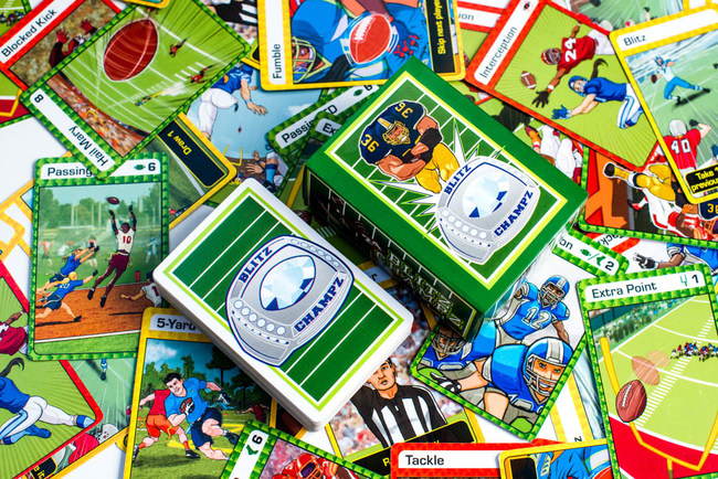 Blitz Champz is a boxed game of 100 playing cards and instructions. The fast-paced game takes 2 minutes to learn and 15-30 minutes to play. The vibrant game cards feature flag and tackle football and both male and female characters.