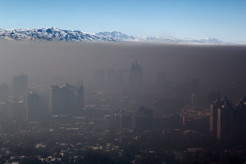 Smart energy and mobility not only safeguard the global climate but also life in urban habitats; smog over Almaty, Kazakhstan. Photo: Igors Jefimovs/wikimedia commons (PRNewsfoto/HFT Stuttgart)