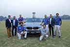 (L-R) Mr. Adhiraj Singh, CEO and Managing Director at Equisport, Mr. Mihir Dayal, Director, Marketing, BMW India, Winning team - Jindal Panthers and Mr. Vikram Pawah, President, BMW Group India. (PRNewsfoto/BMW India Private Limited)