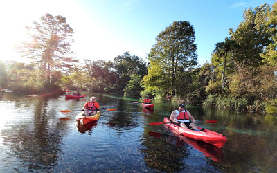 Veterans gather to explore and clean the Weeki Wachee River (Florida) by kayak via a Wounded Warrior Project alumni program.