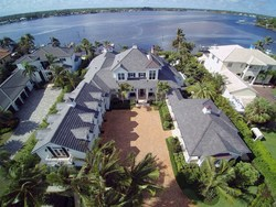 Aerial picture of Anderson home in Jupiter, Florida. This home, with its DaVinci Roofscapes composite roofing tiles, survived Hurricane Irma's 90+mph winds with no damage.