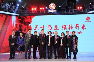 Members of Yum China's leadership team celebrate 30 years in China