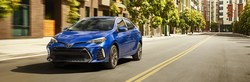 Front exterior view of a blue 2018 Toyota Camry.