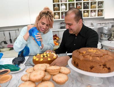 Billie Piper helps owner Lorenzo Khan bake cakes at her local favourite shop, The Cake House in London, as she partners with Amex to encourage people to go out and 'Shop Small' this Saturday. (PRNewsfoto/Small Business Saturday)