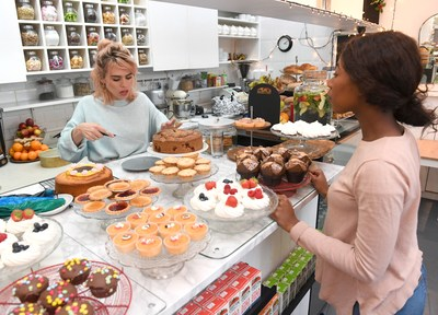 Billie Piper serves cakes at her local favourite shop, The Cake House in London, as she partners with Amex to encourage people to go out and 'Shop Small' this Saturday. (PRNewsfoto/Small Business Saturday)