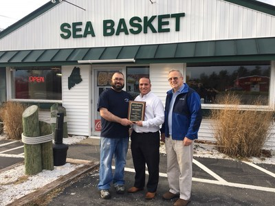 Louis Rylant, owner of the Seabasket Restaurant accepts award for Best Seafood Restaurant Midcoast Maine from Market Surveys of America
