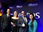 SHIFT Communications' Alan Marcus, Amy Lyons, Justin Finnegan and Defausha Hampton accept the PR News 'Top Place to Work in PR' Award in New York City.