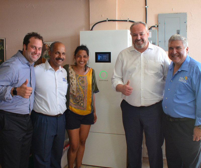 Christoph Ostermann, global CEO of sonnen, and Blake Richetta, SVP of sonnen, Inc., with Pura Energia's David Portalatin and community spokesperson, Christine Nievas at the sonnen microgrid in Humacao.