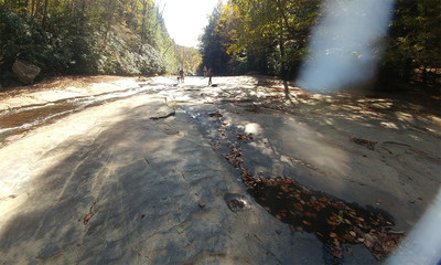 Veterans hike Ohiopyle State Park's Flat Rock area as part of a WWP event.