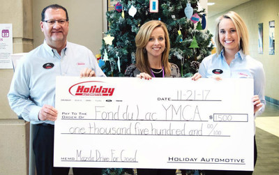 Holiday Mazda presenting its $1,500 check to the local YMCA.