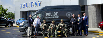 Holiday Ford presenting a Ford Transit to the local SWAT team.