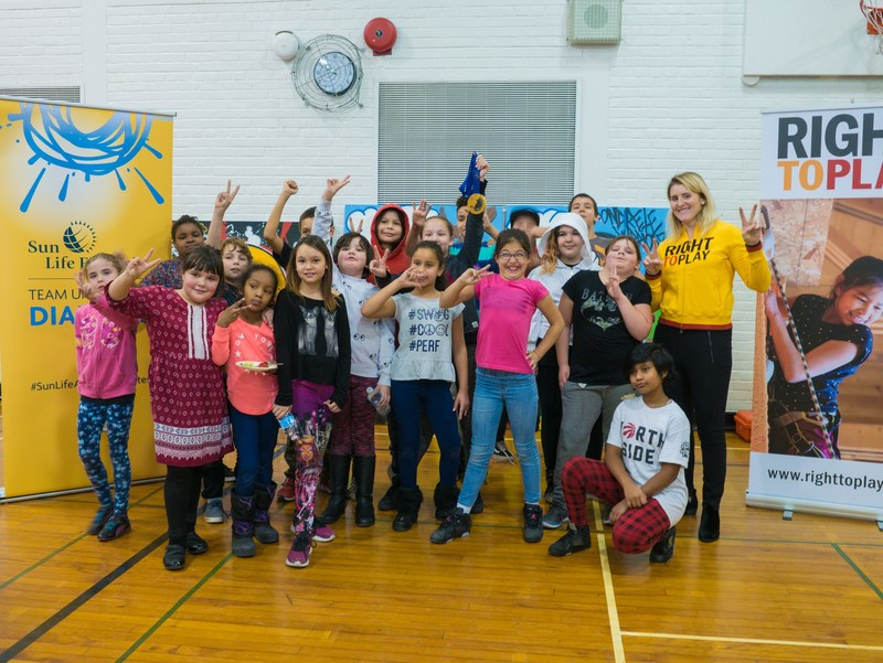 Canadian Ice Hockey player and six-time Olympian Hayley Wickenheiser joins Sun Life, Right to Play, and Elders from the First Nations School of Toronto to announce a commitment to Right to Play's Play for Prevention Program. (CNW Group/Sun Life Financial Inc.)