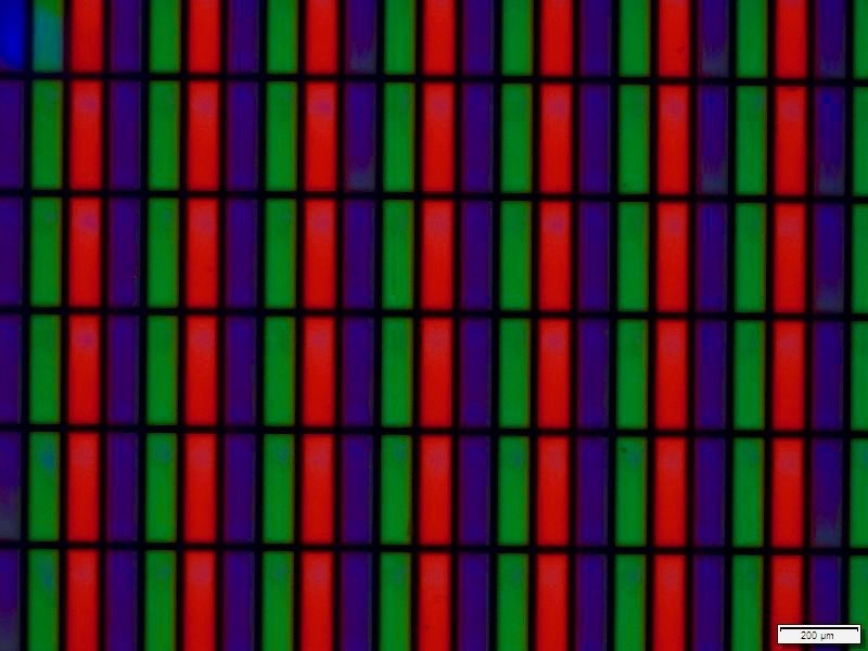 """Microscope image of ink jet printed red and green Cadmium-free Quantum Dot color conversion layer. Printed Quantum Dots can improve LCD efficiency by as much as 300% and could solve key manufacturing challenges for next generation microLED displays. This device will be demonstrated by Nanosys and DIC Global at the IDW Conference in Sendai, Japan. Pixel size shown here is equivalent to that of a 50"""" UltraHD TV. Blue pixels are clear, passing blue light through from the display's backlight."""
