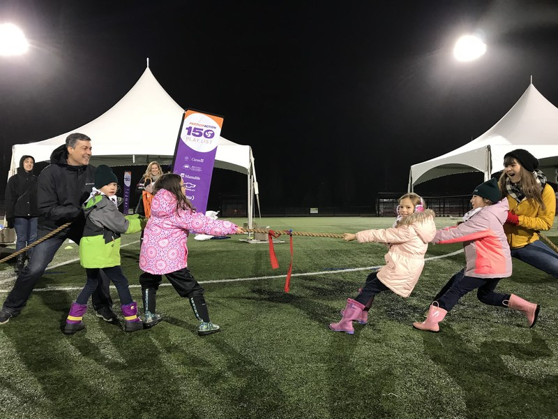 Elio Antunes, President and CEO of ParticipACTION and Play List Ambassador, Sara Hennessey tackle #121 Tug of War with the Girl Guides of Lougheed Area at the final tour stop in Coquitlam, B.C. on November 30. (CNW Group/ParticipACTION)