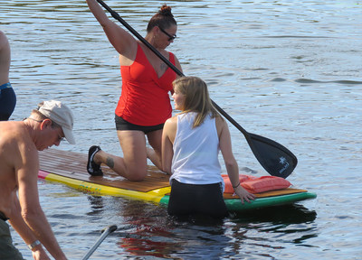 Veterans, friends, and family paddleboard during a recent WWP event.