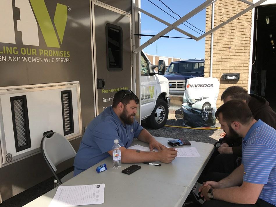 DAV National Service Officer Supervisor Steve Strodtbeck helps local veterans at the Hankook-DAV MSO Stop at Major League Tire in Mentor, Ohio.