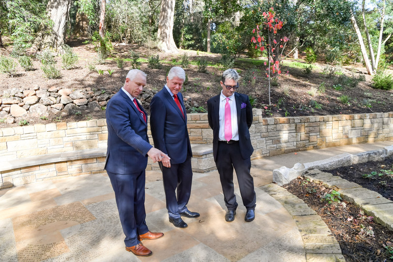 President Bill Clinton pays tribute to those lost to AIDS at National AIDS Memorial during World AIDS Day ceremonies in San Francisco Pictured with the President L-R) John Cunningham, Executive Director and Mike Shriver, Board Chair, National AIDS Memorial. (Photo Credit: Trish Tunney)