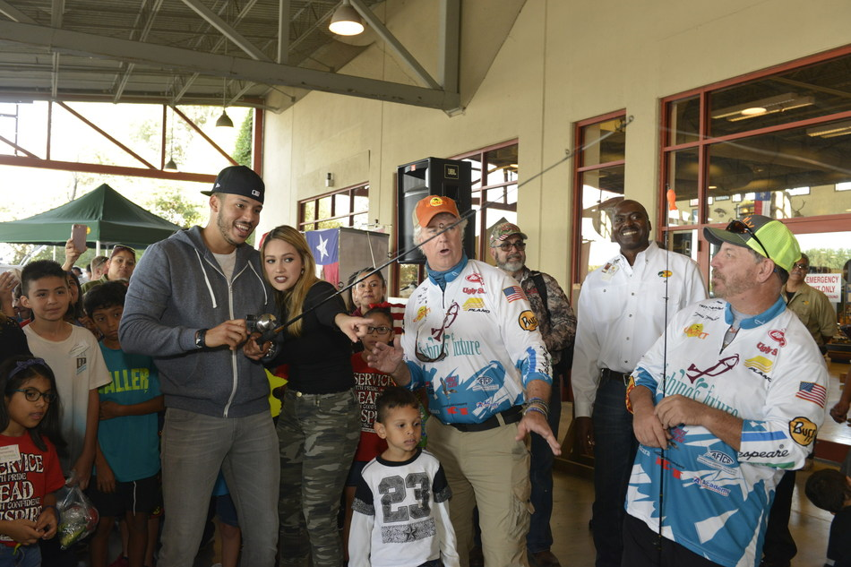 2017 World Series Champion and Houston Astros shortstop, Carlos Correa and fiancé, Daniella Rodriguez, in partnership with Vamos A Pescar, share the joy of fishing with  more than 100 families by reeling in their #FirstCatch at fishing workshop in Katy,TX. (Credit: Anthony Rathbun, AP Newswire)