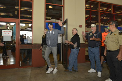 2017 World Series Champion and Houston Astros shortstop, Carlos Correa and fiancé, Daniella Rodriguez, in partnership with Vamos A Pescar, surprised more than 100 families at Bass Pro Shops in Katy, TX. (Credit: Anthony Rathbun, AP Newswire)