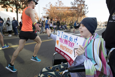 St. Jude patient Keenan cheers on participants of the 16th annual St. Jude Memphis Marathon Weekend.