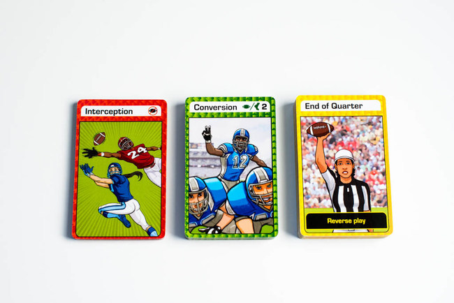 Players use red Defensive Cards, green Offensive Cards, and yellow Continuation Cards in an effort to become the first player to score 21 or more points to win the game.