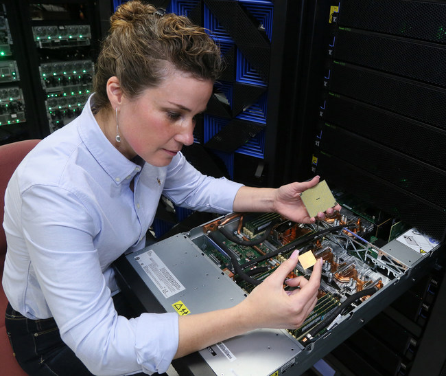 The IBM POWER9 processor delivers unprecedented speeds for deep learning and AI workloads. IBM Engineer, Stefanie Chiras tests the IBM Power System server in Austin, Texas. (Photo Credit: Jack Plunkett/Feature Photo Service for IBM).