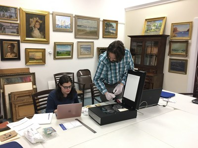 LIU Palmer School of Library & Information Science students digitally archiving documents at the Southold Historical Society.