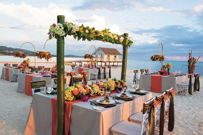 A gorgeous beach reception, taking design inspiration from Sandals Resorts' new destination wedding program, Aisle to Isle