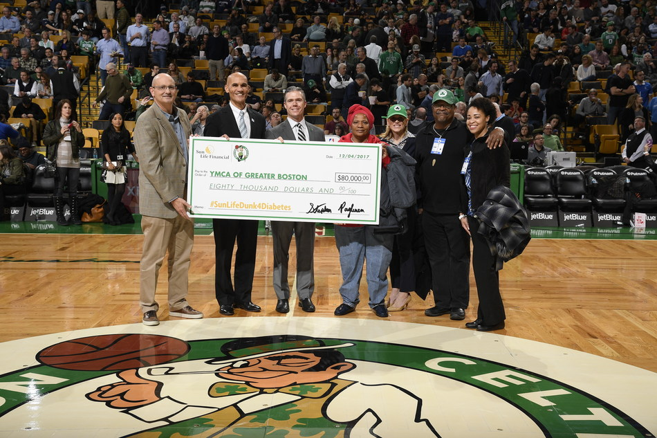 Sun Life presents $80,000 to YMCA of Greater Boston at Celtics v. Bucks game, Dec 4. (From L to R: Kevin Krzeminski, Senior VP, Sun Life; James Morton, CEO, YMCA of Greater Boston; Ted Dalton, Senior VP, Boston Celtics; Michelle Eden, Roxbury YMCA Diabetes Prevention Program participant; Julie Lima, Chief Development Officer, YMCA of Greater Boston; Paul Cato, Roxbury YMCA Diabetes Prevention Program participant)