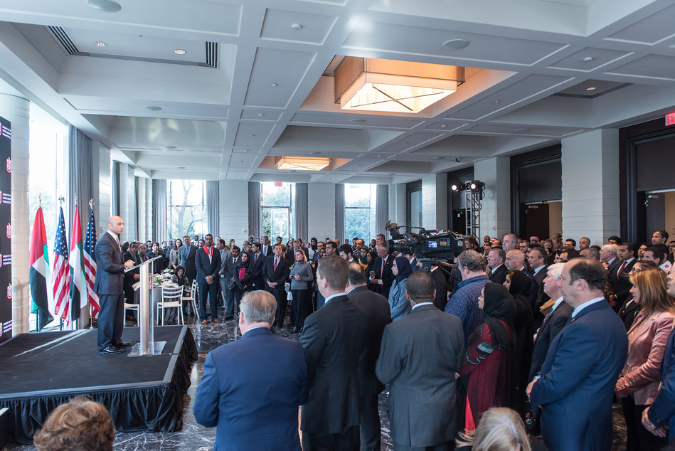"""Ambassador Yousef Al Otaiba welcomes guest to the Embassy of the United Arab Emirates for UAE's 46th National Day, highlighting how the UAE and US are """"United in Prosperity"""" and working together to deepen trade and economic relations for the mutual benefit of both countries."""