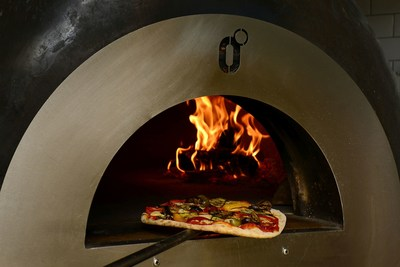 Winner: Zerodegrees – a shot of the pizza going into the wood fired pizza oven (PRNewsfoto/Zerodegrees)