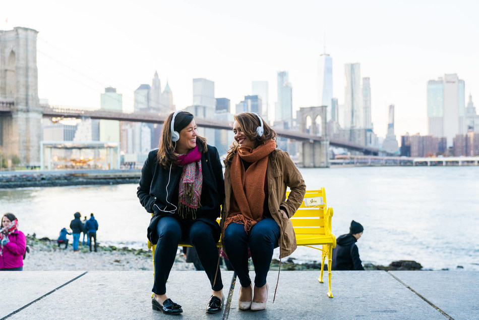 Co-CEOs Naomi Hirabayashi and Marah Lidey 'press pause' on Shine's iconic yellow bench in celebration of the app's launch.