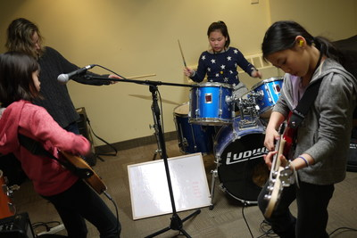 """Girls taking part in """"Girls Rock Camp"""" rock out during the March Break session. Girls Rock Camp is a free program offered to Dixon Hall Music School students, due to popular demand. (CNW Group/Dixon Hall Neighbourhood Services)"""