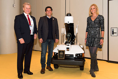 Michael Madsen, Publisher of American Security Today, with Sharp Electronics' Cliff Quiroga, Vice President for Sharp Robotics Business Development, and Sharp Robotics' Director of Marketing, Alice DiSanto.  Featured is the ASTORS Award Winning Sharp INTELLOS A-UGV.