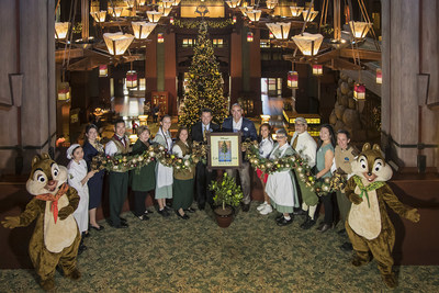 DISNEY'S GRAND CALIFORNIAN HOTEL & SPA (ANAHEIM, Calif.) - On December 6, 2017, hotel leaders and cast members celebrated the completion of the hotel-wide renovation at Disney's Grand Californian Hotel & Spa. To commemorate the occasion, an emblematic orange tree was presented to the hotel's cast. Completely redesigned guest rooms plus a refreshed lobby, pool area and concierge-level lounge were part of the most extensive refurbishment since the hotel's 2001 opening. (Disneyland Resort)