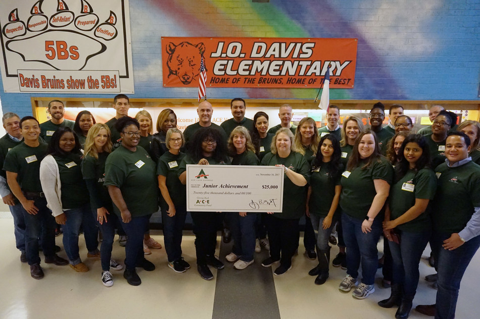 ACE volunteers present annual donation to Junior Achievement at JA in a Day