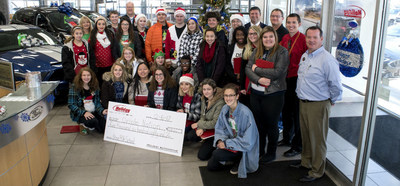 The Holiday Ford team presenting Horace Mann High School with a check for $5,680.