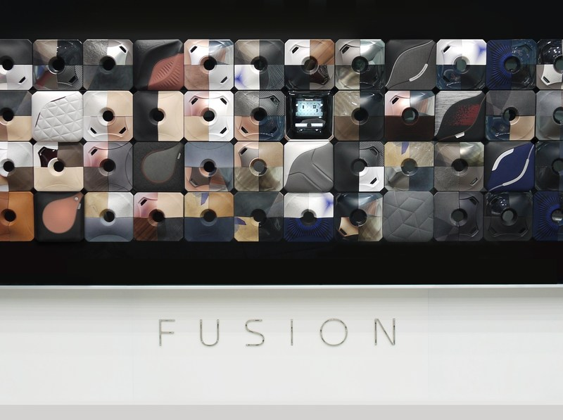 "Faurecia's ""Fusion"" collection of surface materials demonstrates expertise in integrating electronics, displays and decoration parts into vehicles for an innovative HMI (human machine-interface) and connectivity experience."