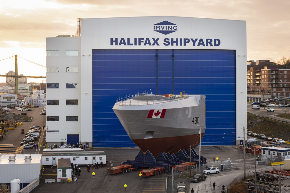Today, Dec. 8, 2017, the bow section of the first Arctic and Offshore Patrol Ship, the future HMCS Harry DeWolf, was transported on heavy lift transporters from inside the Halifax Shipyard's indoor shipbuilding facility outside to land level. (CNW Group/Irving Shipbuilding Inc.)