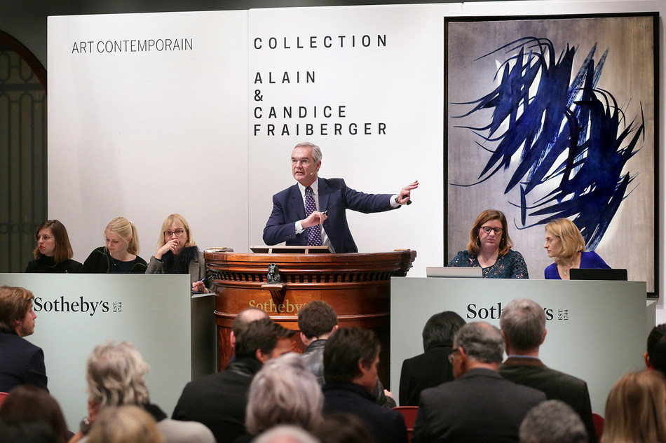 Philipp Herzog von Württemberg, Sotheby's European Chairman, fields bids during the Company's recent sales of Contemporary Art in Paris that totaled $51.1 million.