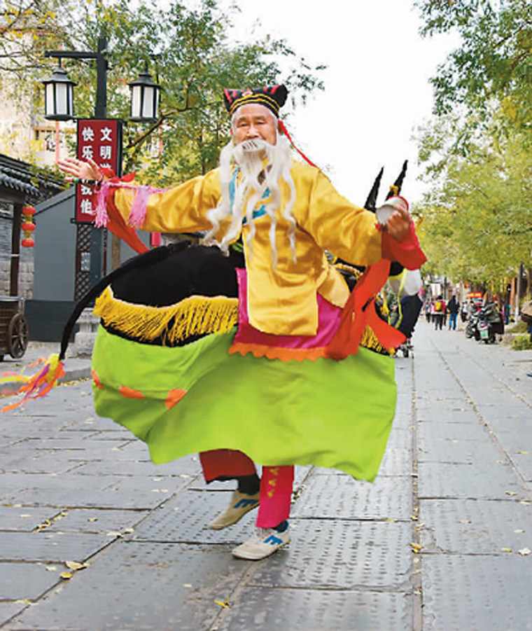 Performance of cultural heritage in the streets for residents and tourists. (PRNewsfoto/The Publicity Department of the)