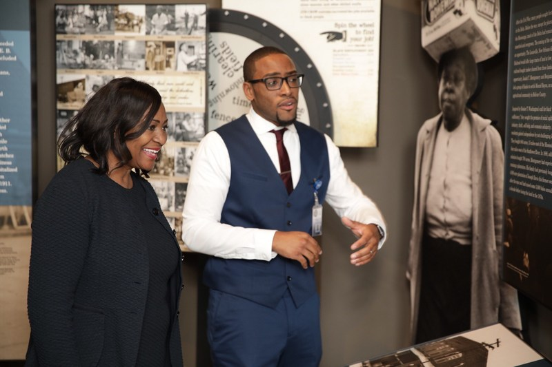 W.K. Kellogg Foundation President and CEO La June Montgomery Tabron with museum guide in front of the Mound Bayou exhibit, during tour of the Mississippi Civil Rights Museum.