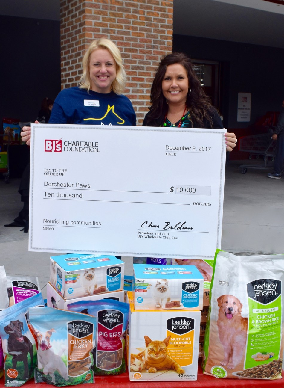Dawn Albright, general manager of the BJ's Wholesale Club in Summerville, SC, presents a $10,000 grant to Kim Almstedt, executive director of Dorchester Paws.