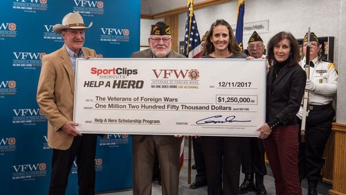 Sport Clips Haircuts donated $1.25 million to the Veterans of Foreign Wars Foundation today for Help A Hero Scholarships for U.S. service members and veterans. (L to R) Gordon Logan, Sport Clips Haircuts founder and CEO and an Air Force veteran, made the presentation to VFW National Commander Keith E. Harman; along with Amanda Palm, Sport Clips corporate communications manager, who oversees the Help A Hero program; and Martha England, Sport Clips vice president of Marketing.
